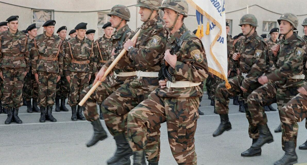 Bosnian soldiers march in Sarajevo on November 24, 1991